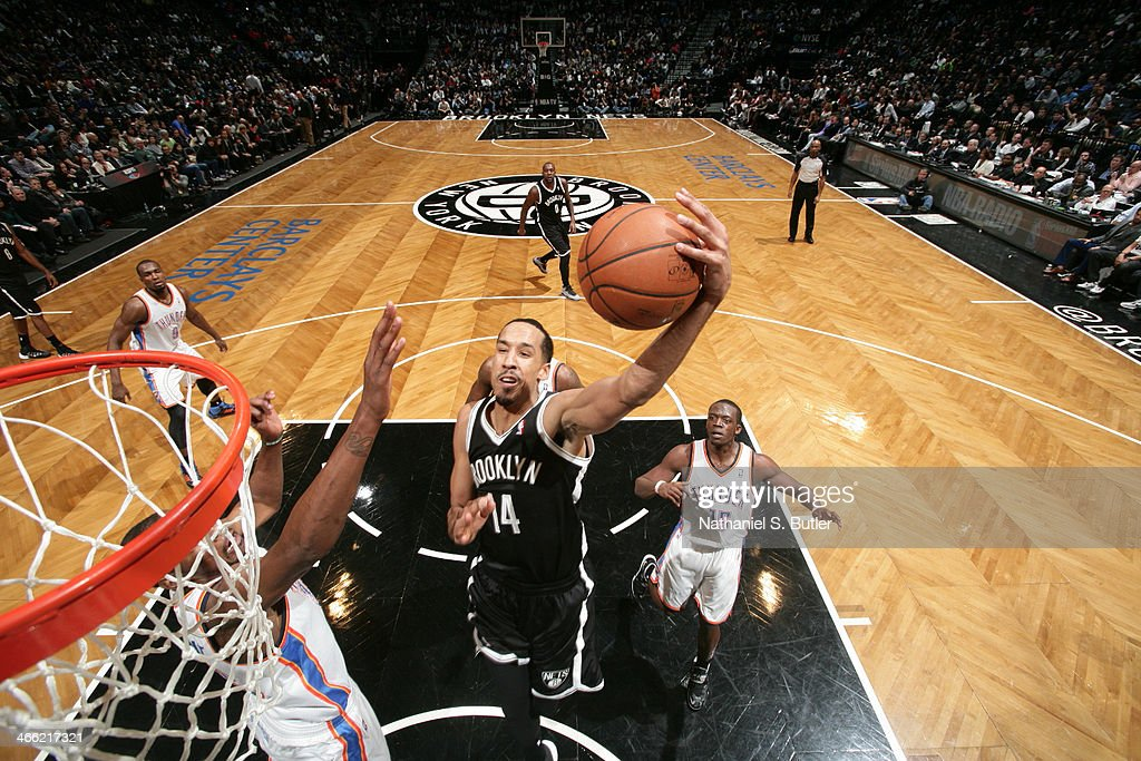 <a gi-track='captionPersonalityLinkClicked' href=/galleries/search?phrase=Shaun+Livingston&family=editorial&specificpeople=202955 ng-click='$event.stopPropagation()'>Shaun Livingston</a> #14 of the Brooklyn Nets shoots against the Oklahoma City Thunder at the Barclays Center on January 31, 2014 in the Brooklyn borough of New York City.