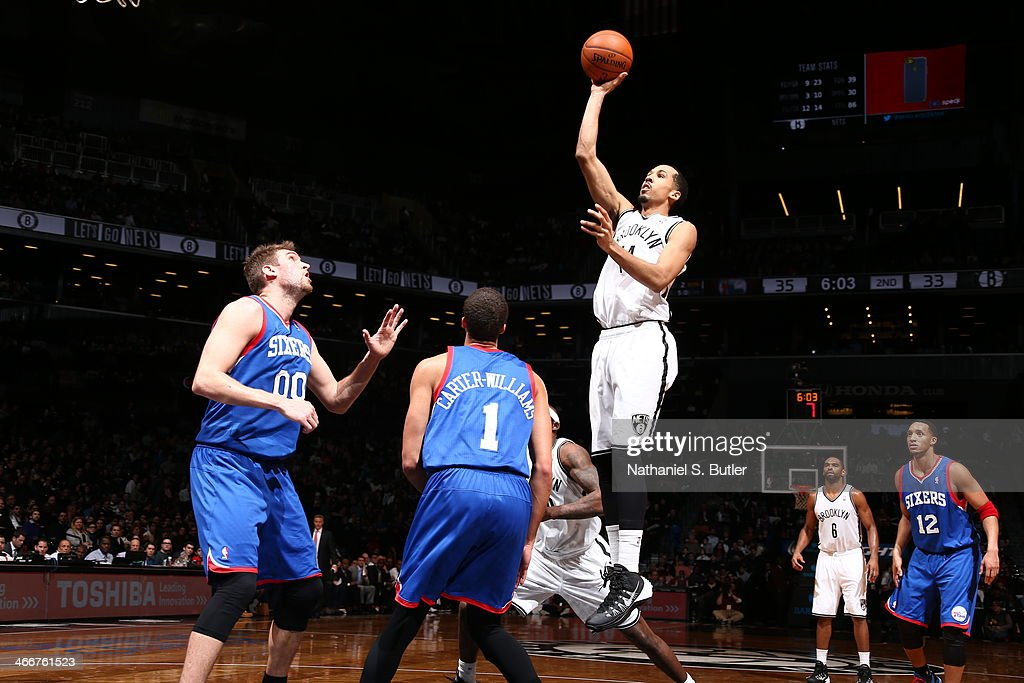 <a gi-track='captionPersonalityLinkClicked' href=/galleries/search?phrase=Shaun+Livingston&family=editorial&specificpeople=202955 ng-click='$event.stopPropagation()'>Shaun Livingston</a> #14 of the Brooklyn Nets shoots over Michael Carter-Williams #1 of the Philadelphia 76ers during a game at Barclays Center in Brooklyn.