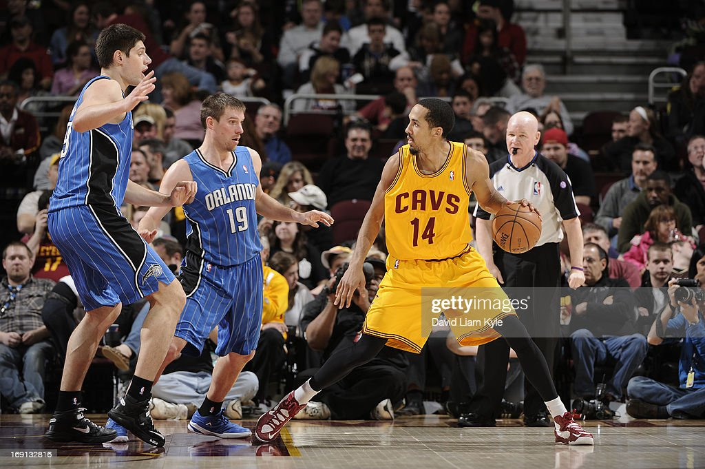 Shaun Livingston #14 of the Cleveland Cavaliers controls the ball against Nikola Vucevic #9 and Beno Udrih #19 of the Orlando Magic at The Quicken Loans Arena on April 7, 2013 in Cleveland, Ohio.