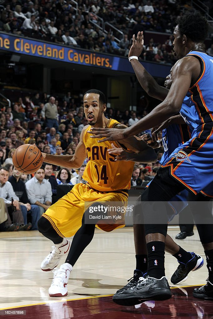 <a gi-track='captionPersonalityLinkClicked' href=/galleries/search?phrase=Shaun+Livingston&family=editorial&specificpeople=202955 ng-click='$event.stopPropagation()'>Shaun Livingston</a> #14 of the Cleveland Cavaliers drives baseline for the score against the Oklahoma City Thunder at The Quicken Loans Arena on February 2, 2013in Cleveland, Ohio.
