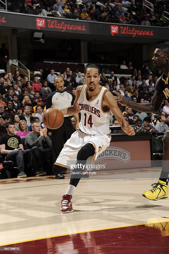 <a gi-track='captionPersonalityLinkClicked' href=/galleries/search?phrase=Shaun+Livingston&family=editorial&specificpeople=202955 ng-click='$event.stopPropagation()'>Shaun Livingston</a> #14 of the Cleveland Cavaliers drives to the basket against the Indiana Pacers at The Quicken Loans Arena on March 18, 2013 in Cleveland, Ohio.
