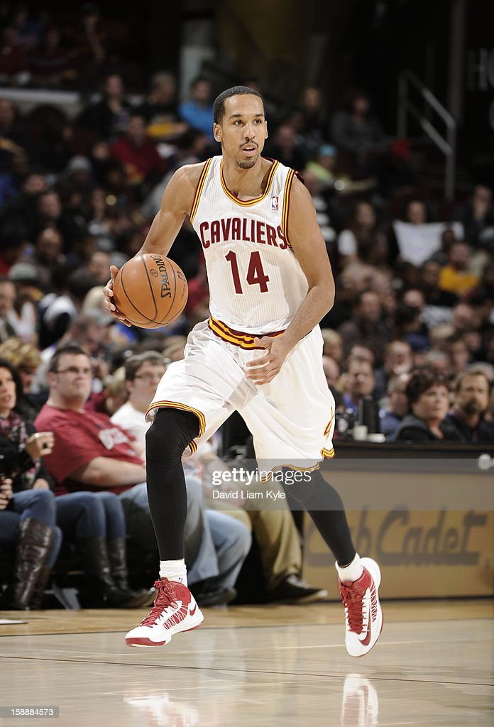 <a gi-track='captionPersonalityLinkClicked' href=/galleries/search?phrase=Shaun+Livingston&family=editorial&specificpeople=202955 ng-click='$event.stopPropagation()'>Shaun Livingston</a> #14 of the Cleveland Cavaliers handles the ball up-court in his first game as a Cavalier against the Sacramento Kings at The Quicken Loans Arena on January 2, 2013 in Cleveland, Ohio.