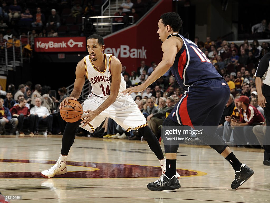 Shaun Livingston #14 of the Cleveland Cavaliers looks to pass the ball defended by John Jenkins #12 of the Atlanta Hawks at The Quicken Loans Arena on January 9, 2013 in Cleveland, Ohio.