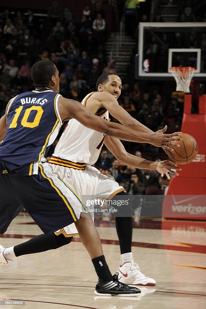 <a gi-track='captionPersonalityLinkClicked' href=/galleries/search?phrase=Shaun+Livingston&family=editorial&specificpeople=202955 ng-click='$event.stopPropagation()'>Shaun Livingston</a> #14 of the Cleveland Cavaliers passes the ball against the Utah Jazz at The Quicken Loans Arena on March 6, 2013 in Cleveland, Ohio.