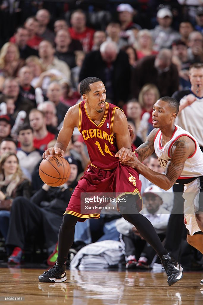 Shaun Livingston #14 of the Cleveland Cavaliers posts up against Damian Lillard #0 of the Portland Trail Blazers on January 16, 2013 at the Rose Garden Arena in Portland, Oregon.