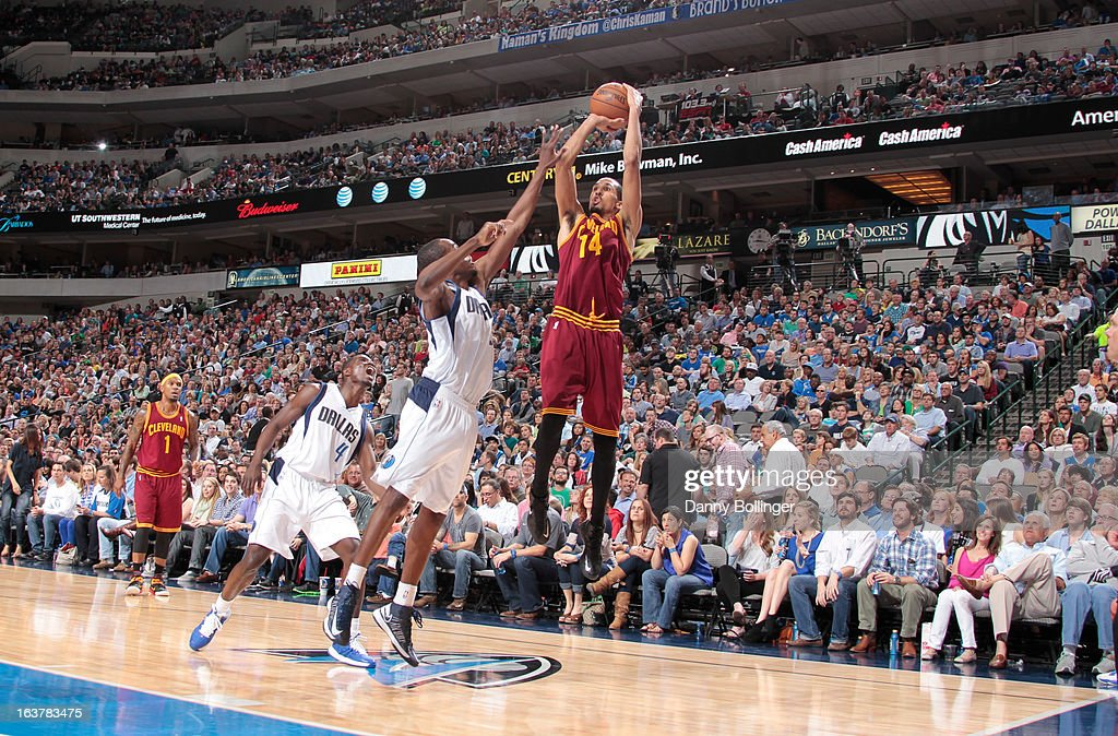<a gi-track='captionPersonalityLinkClicked' href=/galleries/search?phrase=Shaun+Livingston&family=editorial&specificpeople=202955 ng-click='$event.stopPropagation()'>Shaun Livingston</a> #14 of the Cleveland Cavaliers shoots a jumper against <a gi-track='captionPersonalityLinkClicked' href=/galleries/search?phrase=Rodrigue+Beaubois&family=editorial&specificpeople=5299423 ng-click='$event.stopPropagation()'>Rodrigue Beaubois</a> #3 of the Dallas Mavericks on March 15, 2013 at the American Airlines Center in Dallas, Texas.