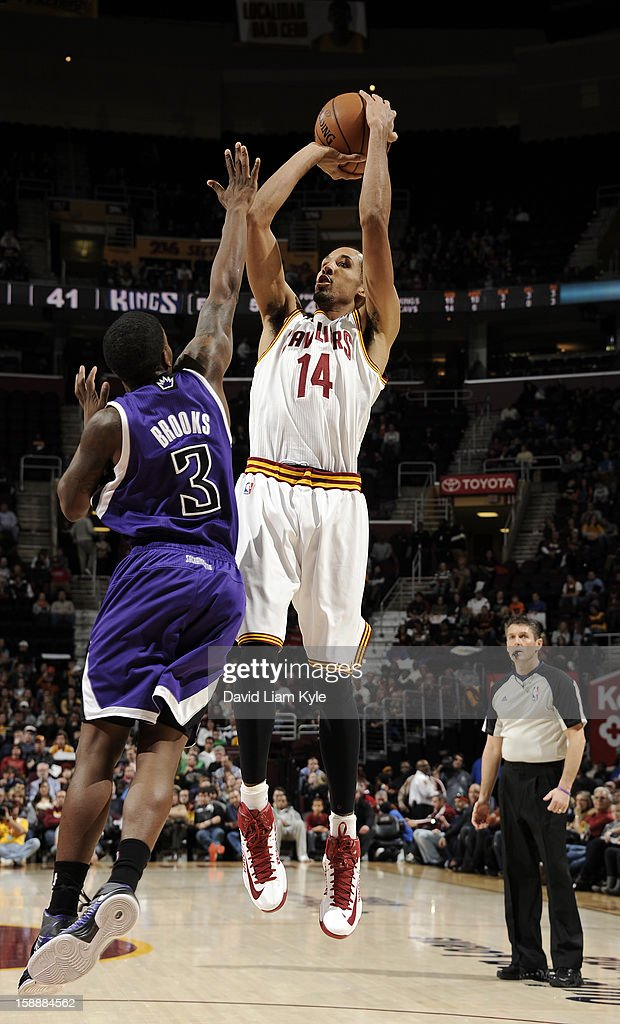 Shaun Livingston #14 of the Cleveland Cavaliers shoots against Aaron Brooks #3 of the Sacramento Kings at The Quicken Loans Arena on January 2, 2013 in Cleveland, Ohio.