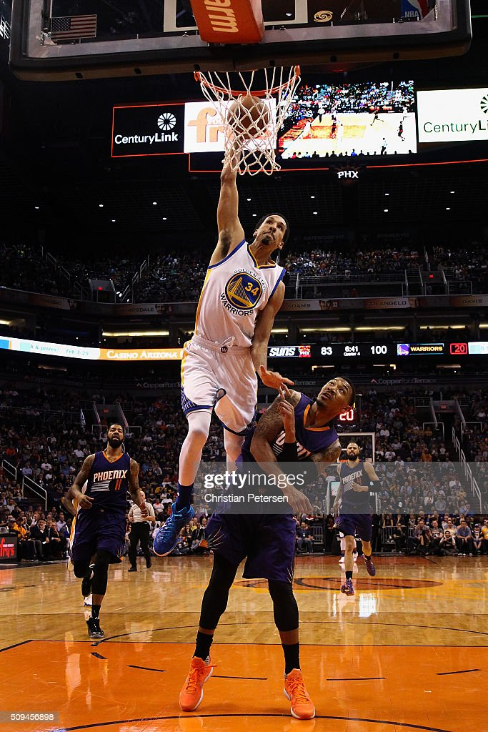 Shaun Livingston of the Golden State Warriors attempts a slam dunk over Orlando Johnson of the Phoenix Suns during the second half of the NBA game at...