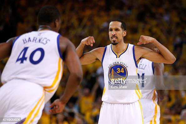 Shaun Livingston of the Golden State Warriors celebrates with teammate Harrison Barnes in the second half against the Houston Rockets during game...