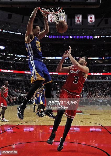Shaun Livingston of the Golden State Warriors dunks over Doug McDermott of the Chicago Bulls at the United Center on January 20 2016 in Chicago...