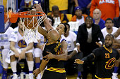 Shaun Livingston of the Golden State Warriors dunks the ball over Richard Jefferson of the Cleveland Cavaliers during the second quarter in Game 5 of...