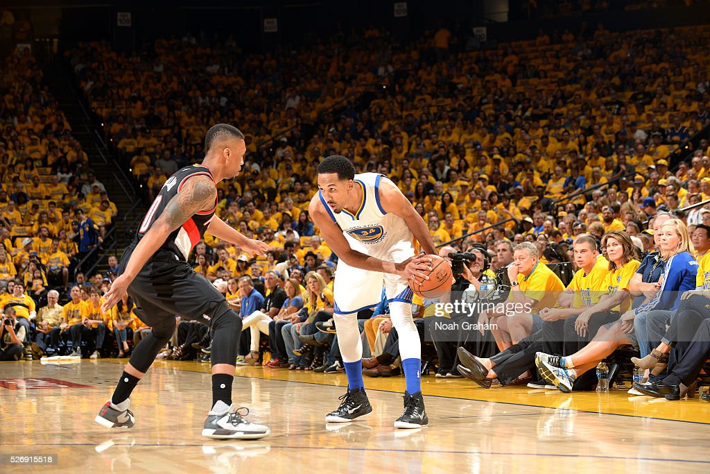 Shaun Livingston #34 of the Golden State Warriors handles the ball during the game against Damian Lillard #0 of the Portland Trail Blazers in Game One of the Western Conference Semifinals during the 2016 NBA Playoffs on May 1, 2016 at ORACLE Arena in Oakland, California.