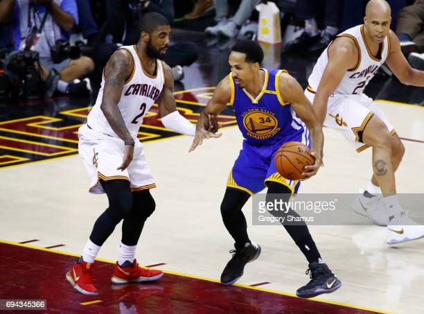 Shaun Livingston of the Golden State Warriors is defended by Kyrie Irving of the Cleveland Cavaliers during the first half in Game 4 of the 2017 NBA...