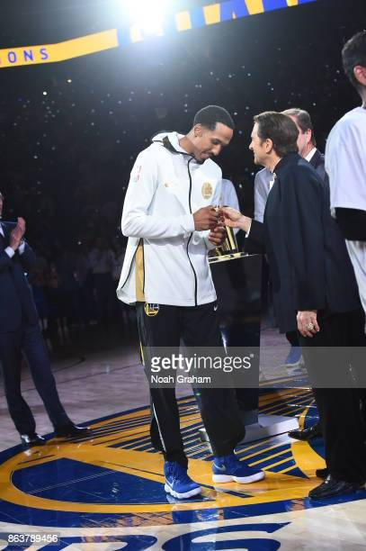 Shaun Livingston of the Golden State Warriors receives his rings during the NBA Championship ring ceremony before the game against the Houston Rockes...