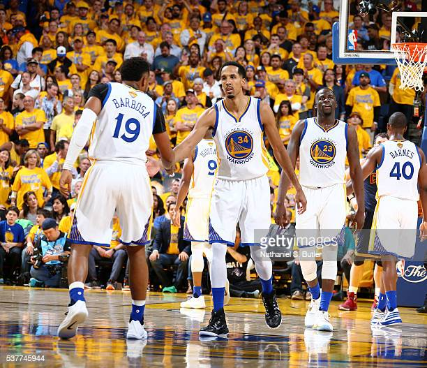 Shaun Livingston of the Golden State Warriors shakes hands with his teammates during the game against the Cleveland Cavaliers in Game One of the 2016...