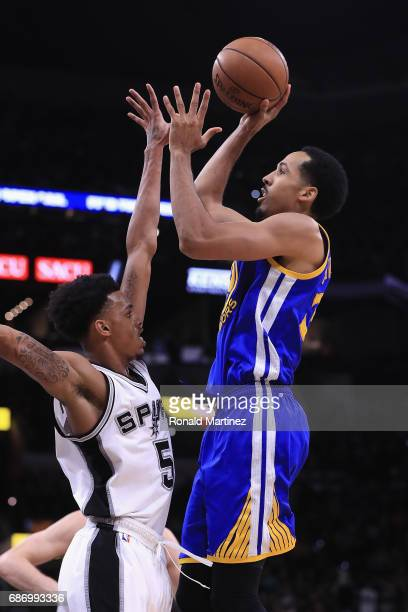 Shaun Livingston of the Golden State Warriors shoots the ball against Dejounte Murray of the San Antonio Spurs in the first half during Game Four of...