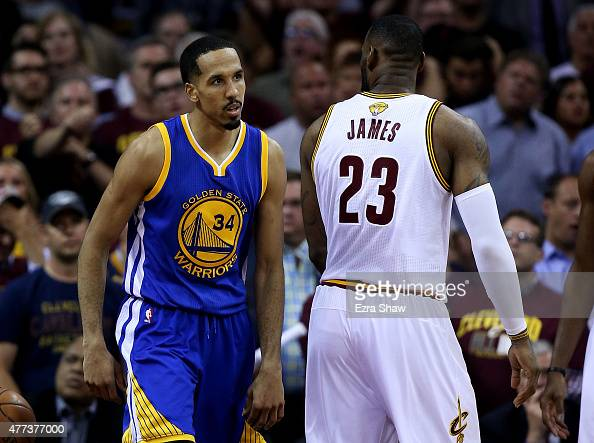 Shaun Livingston of the Golden State Warriors stares down LeBron James of the Cleveland Cavaliers after dunking in the fourth quarter during Game Six...