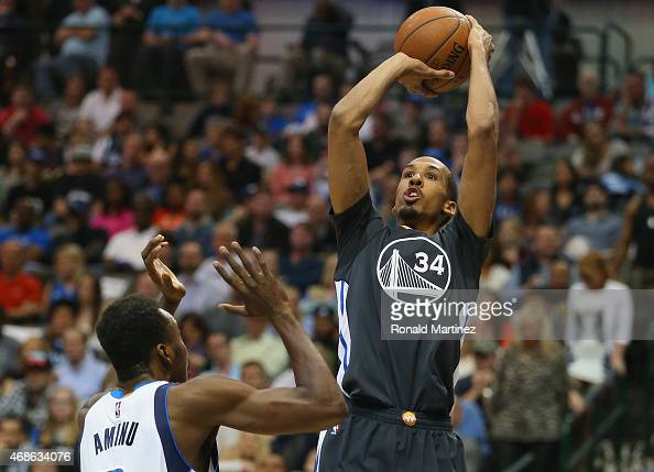 Shaun Livingston of the Golden State Warriors takes a shot against AlFarouq Aminu of the Dallas Mavericks at American Airlines Center on April 4 2015...