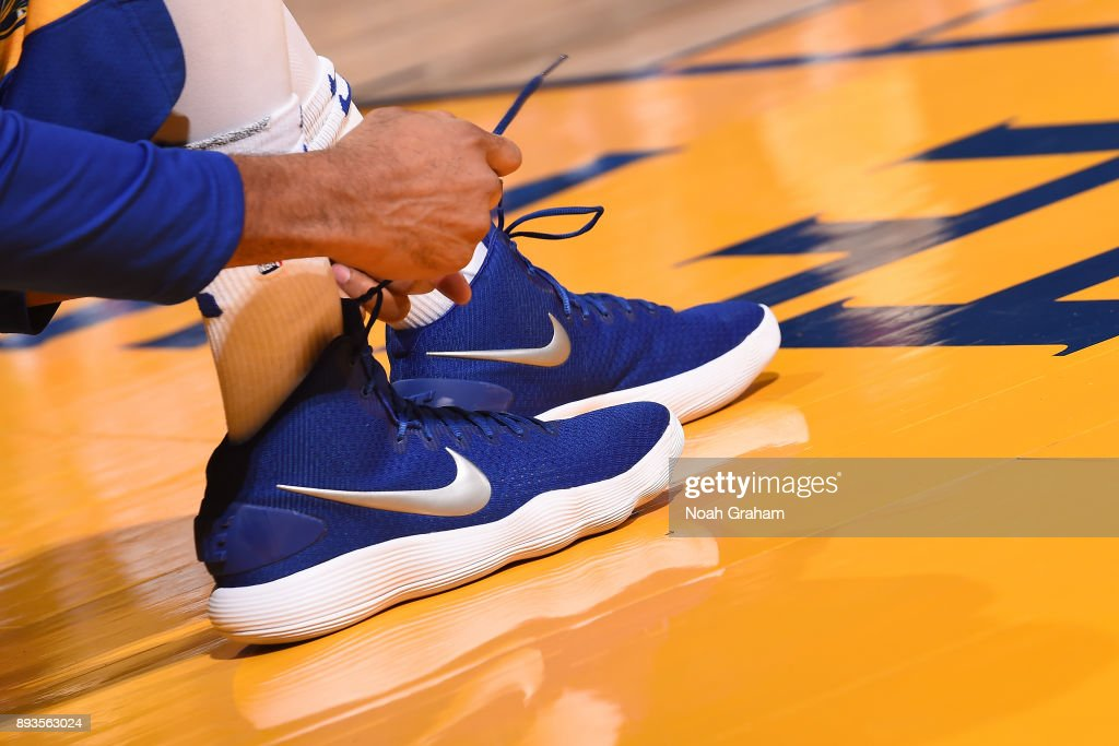 Shaun Livingston #34 of the Golden State Warriors ties his sneakers before the game against the Dallas Mavericks on December 14, 2017 at ORACLE Arena in Oakland, California.