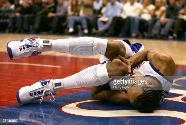 Shaun Livingston of the Los Angeles Clippers grimaces in pain after dislocating his knee against the Charlotte Bobcats during the first quarter at...