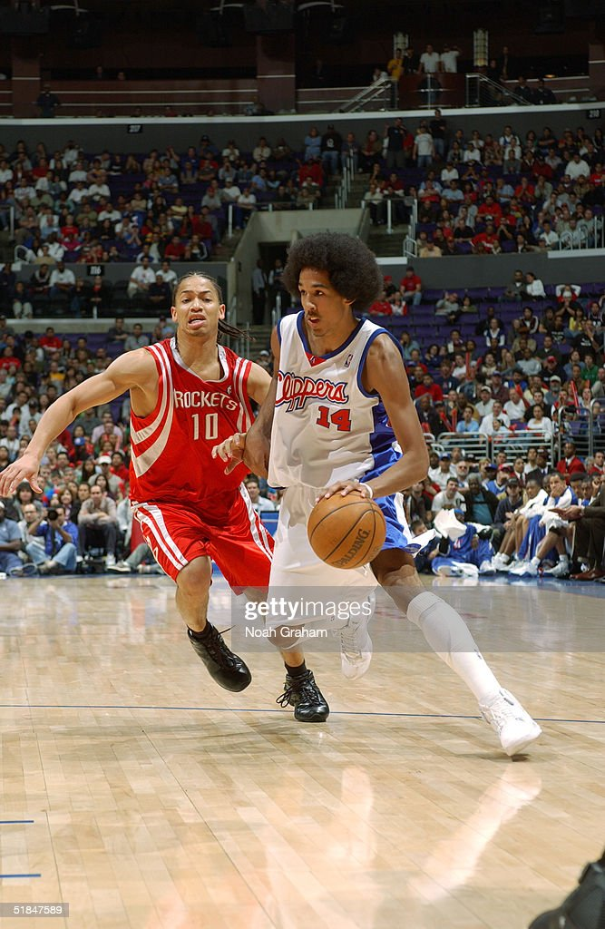 Shaun Livingston #14 of the Los Angeles Clippers moves the ball against Tyronn Lue #10 of the Houston Rockets during the game at Staples Center on November 20, 2004 in Los Angeles, California. The Rockets won in overtime 91-86.