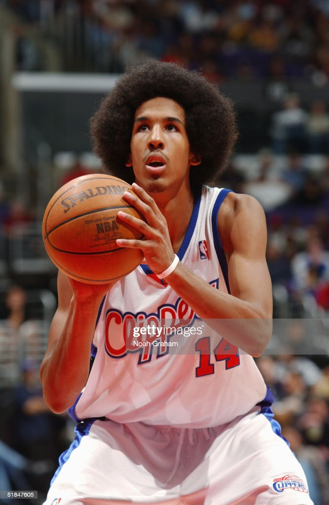 Shaun Livingston #14 of the Los Angeles Clippers shoots a free throw during the game against the Houston Rockets at Staples Center on November 20, 2004 in Los Angeles, California. The Rockets won in overtime 91-86.