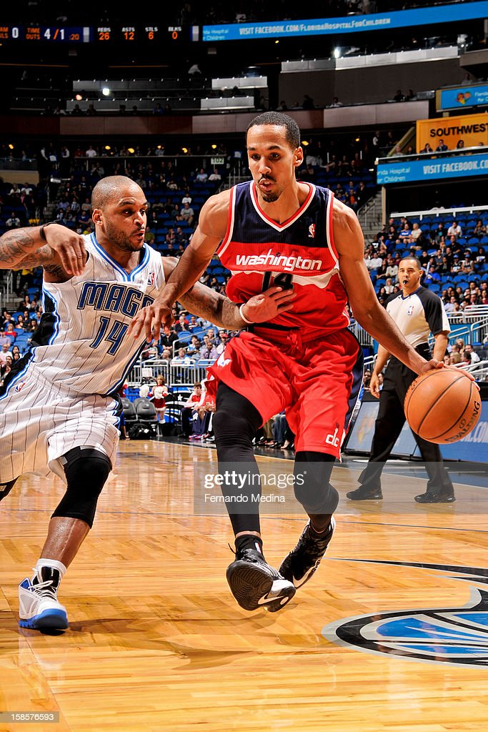 Shaun Livingston #14 of the Washington Wizards drives against Jameer Nelson #14 of the Orlando Magic on December 19, 2012 at Amway Center in Orlando, Florida.