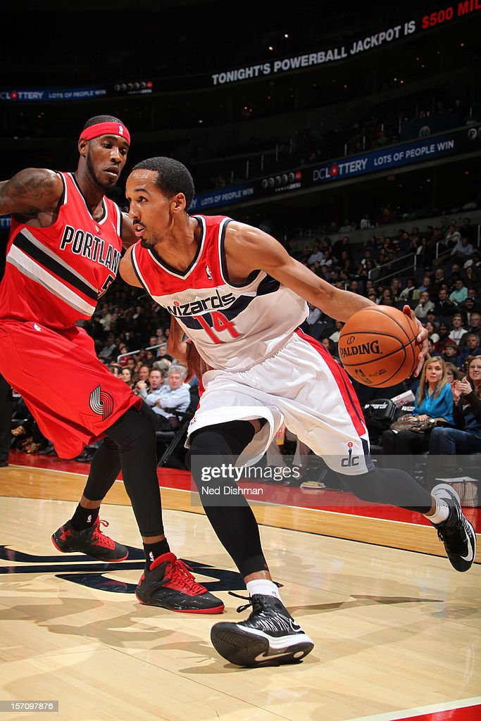 Shaun Livingston #14 of the Washington Wizards drives against Will Barton #5 of the Portland Trail Blazers during the game at the Verizon Center on November 28, 2012 in Washington, DC.
