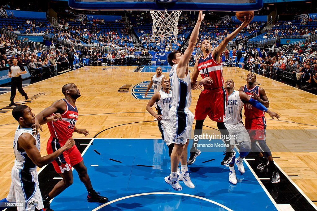 Shaun Livingston #14 of the Washington Wizards drives to the basket against Nikola Vucevic #9 of the Orlando Magic on December 19, 2012 at Amway Center in Orlando, Florida.