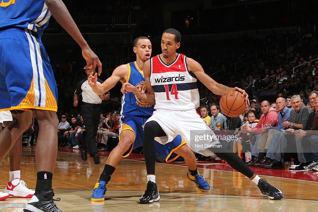 Shaun Livingston #14 of the Washington Wizards handles the ball against Stephen Curry #30 of the Golden State Warriors during the game at the Verizon Center on December 8, 2012 in Washington, DC.