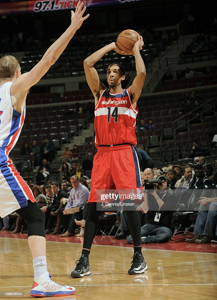 <a gi-track='captionPersonalityLinkClicked' href=/galleries/search?phrase=Shaun+Livingston&family=editorial&specificpeople=202955 ng-click='$event.stopPropagation()'>Shaun Livingston</a> #14 of the Washington Wizards looks to pass the ball against the Detroit Pistons during the game on December 21, 2012 at The Palace of Auburn Hills in Auburn Hills, Michigan.
