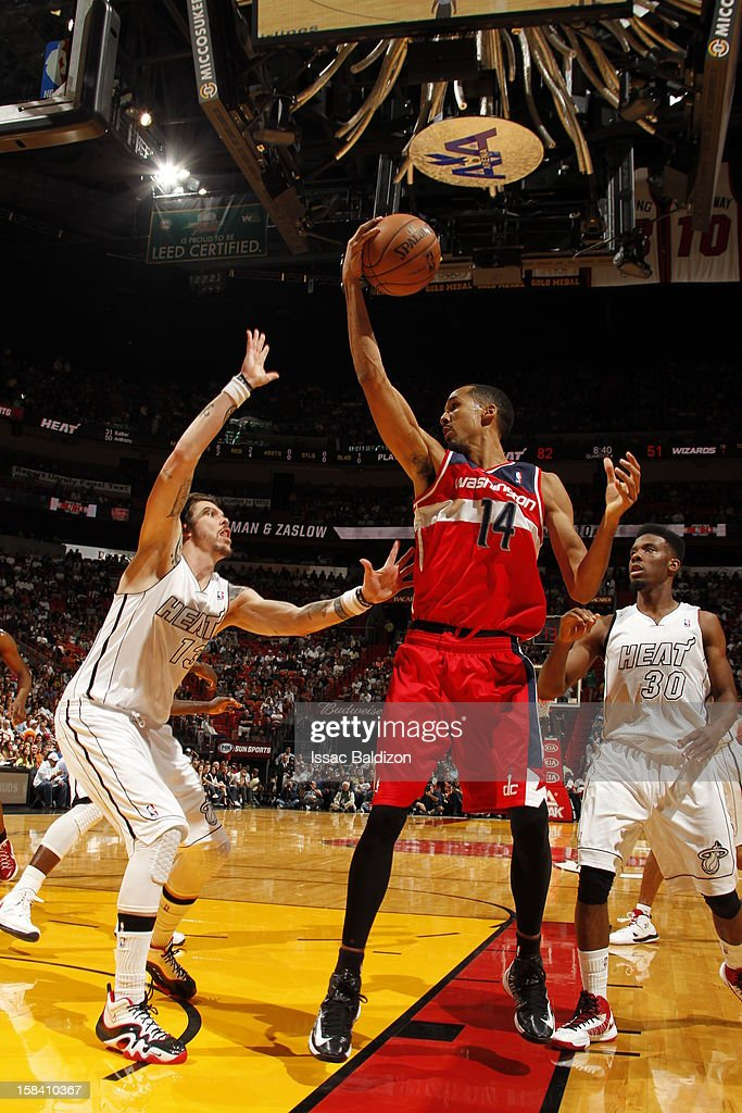 <a gi-track='captionPersonalityLinkClicked' href=/galleries/search?phrase=Shaun+Livingston&family=editorial&specificpeople=202955 ng-click='$event.stopPropagation()'>Shaun Livingston</a> #14 of the Washington Wizards protects the ball from <a gi-track='captionPersonalityLinkClicked' href=/galleries/search?phrase=Mike+Miller+-+Basketball+Player&family=editorial&specificpeople=201801 ng-click='$event.stopPropagation()'>Mike Miller</a> #13 of the Miami Heat during a game between the Washington Wizards and the Miami Heat on December 15, 2012 at American Airlines Arena in Miami, Florida.