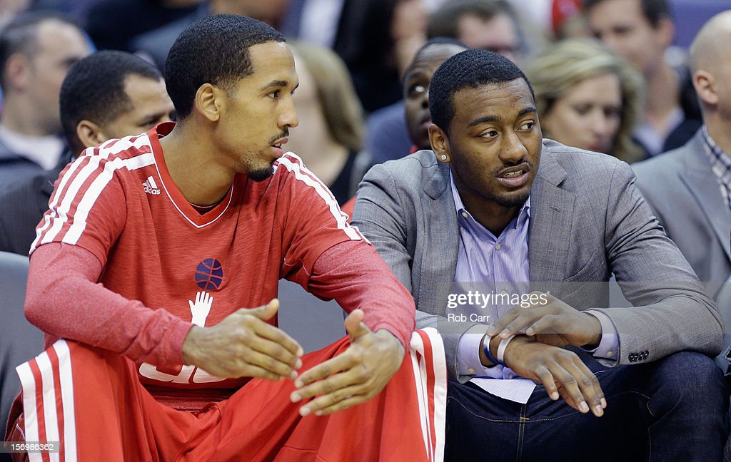<a gi-track='captionPersonalityLinkClicked' href=/galleries/search?phrase=Shaun+Livingston&family=editorial&specificpeople=202955 ng-click='$event.stopPropagation()'>Shaun Livingston</a> #14 of the Washington Wizards (L) talks with teammate <a gi-track='captionPersonalityLinkClicked' href=/galleries/search?phrase=John+Wall&family=editorial&specificpeople=2265812 ng-click='$event.stopPropagation()'>John Wall</a> #2 (R) during the closing moments of the Wizards 118-92 loss to the San Antonio Spurs at Verizon Center on November 26, 2012 in Washington, DC.