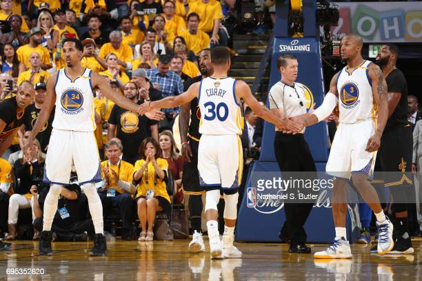 Shaun Livingston Stephen Curry and David West of the Golden State Warriors shake hands in Game Five of the 2017 NBA Finals against the Cleveland...