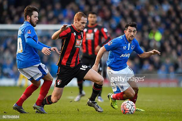 Shaun MacDonald of Bournemouth compete for the ball against Gary Roberts and Marc McNulty of Portsmouth during the Emirates FA Cup Fourth Round match...
