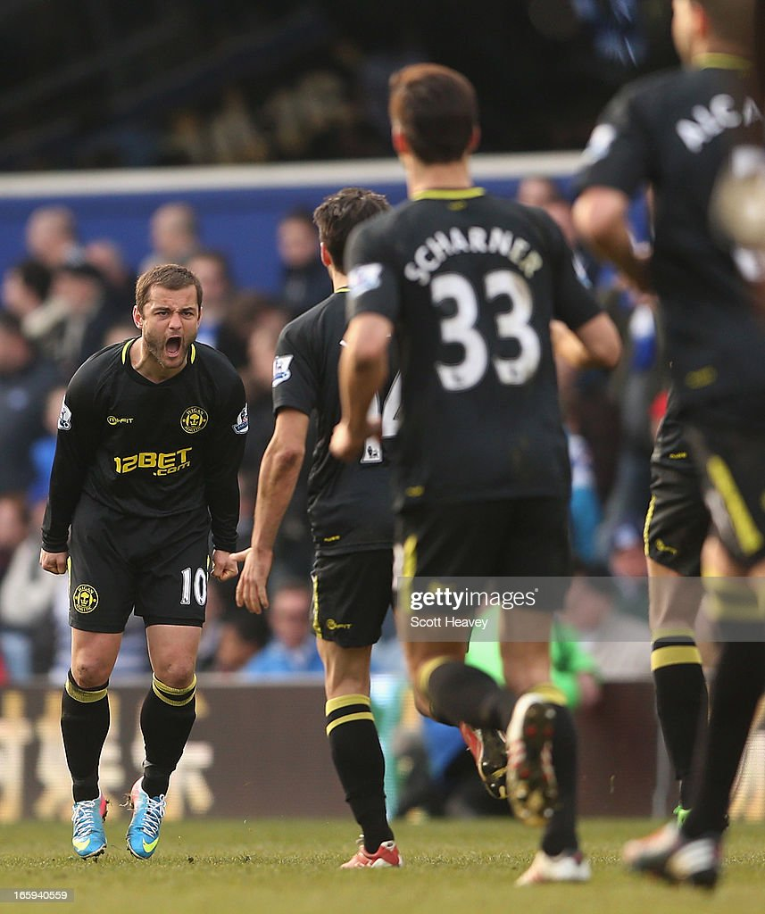 Shaun Maloney of Wigan Athletic celebrates scoring a late equalising goal during the Barclays Premier League match between Queens Park Rangers and Wigan Athletic at Loftus Road on April 7, 2013 in London, England.