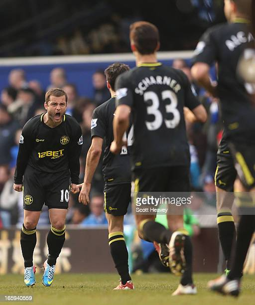 Shaun Maloney of Wigan Athletic celebrates scoring a late equalising goal during the Barclays Premier League match between Queens Park Rangers and...