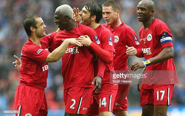 Shaun Maloney of Wigan Athletic celebrates scoring the opening goal with Arouna Kone and team mates during the FA Cup with Budweiser Semi Final match...