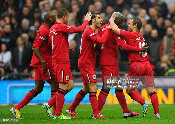 Shaun Maloney of Wigan Athletic celebrates with Arouna Kone and other teammates after scoring the opening goal during the FA Cup with Budweiser Semi...