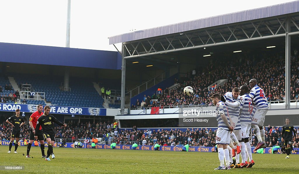 Shaun Maloney of Wigan Athletic scores the equalising goal from a free kick during the Barclays Premier League match between Queens Park Rangers and Wigan Athletic at Loftus Road on April 7, 2013 in London, England.