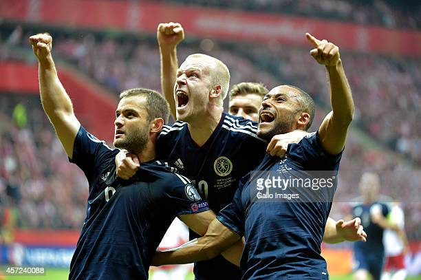Shaun Maloney Steven Naismith and Ikechi Anya celebrating a goal during the UEFA Euro 2016 Qualifying Round match between Poland and Scotland at the...