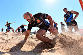 Shaun Malton of Exeter Chiefs sprints up a sand dune during a training session on Exmouth Beach on July 19 2016 in Exmouth England