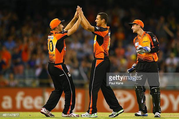 Shaun Marsh and Nathan CoulterNile of the Scorchers celebrate the dismissal of Owais Shah of the Hurricanes during the Big Bash League match between...