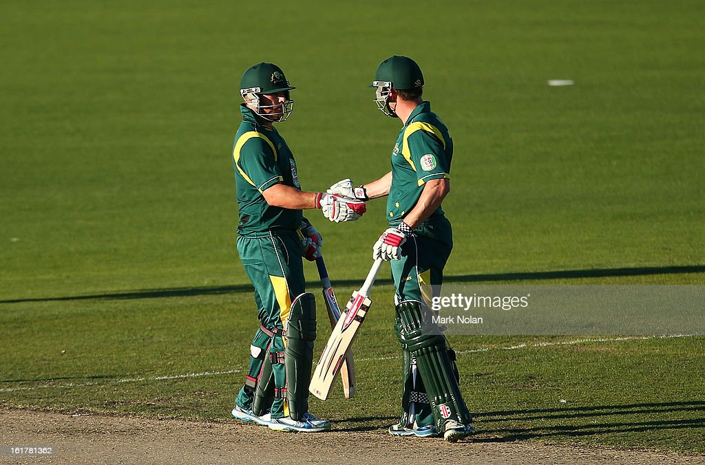 <a gi-track='captionPersonalityLinkClicked' href=/galleries/search?phrase=Shaun+Marsh+-+Cricket+Player&family=editorial&specificpeople=236104 ng-click='$event.stopPropagation()'>Shaun Marsh</a> of Australia A (R) congratulates <a gi-track='captionPersonalityLinkClicked' href=/galleries/search?phrase=Aaron+Finch+-+Cricket+Player&family=editorial&specificpeople=724040 ng-click='$event.stopPropagation()'>Aaron Finch</a> after he scored his half century during the international tour match between Australia 'A' and the England Lions at Blundstone Arena on February 16, 2013 in Hobart, Australia.