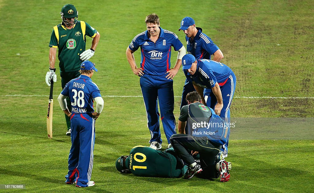 <a gi-track='captionPersonalityLinkClicked' href=/galleries/search?phrase=Shaun+Marsh+-+Cricket+Player&family=editorial&specificpeople=236104 ng-click='$event.stopPropagation()'>Shaun Marsh</a> of Australia A receives attention after injuring his right knee while taking a single during the international tour match between Australia 'A' and the England Lions at Blundstone Arena on February 16, 2013 in Hobart, Australia.