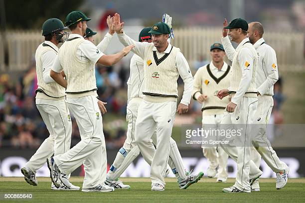 Shaun Marsh of Australia and team mates celebrate the dismissal of Rajendra Chandrika of the West Indies by team mate Nathan Lyon during day two of...