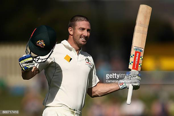 Shaun Marsh of Australia celebrates after reaching his century during day one of the First Test match between Australia and the West Indies at...