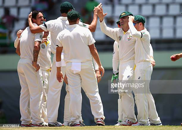 Shaun Marsh of Australia celebrates after taking a catch to claim the wicket of Shai Hope of West Indies off the bowling of Mitchell Johnson of...