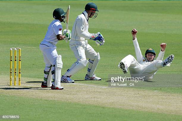 Shaun Marsh of Australia celebrates after taking a catch to dismiss Temba Bavuma of South Africa during day One of the First Test match between...
