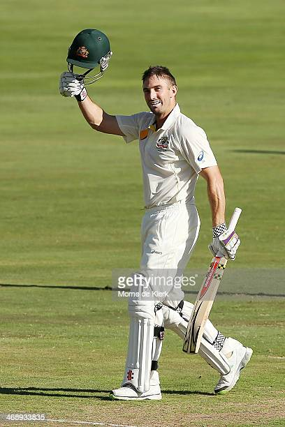Shaun Marsh of Australia celebrates reaching 100 runs during day one of the First Test match between South Africa and Australia on February 12 2014...